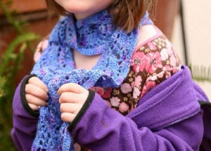 The Crocus Scarf is a fun crochet scarf pattern is the perfect scarf for the cold.