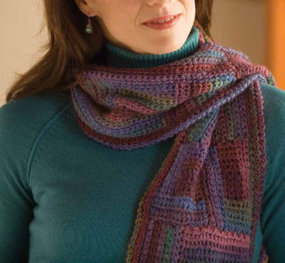 The Labyrinth Colorful Scarf by Kristin Omdahl is a crochet scarf pattern that combines two colorful motifs.