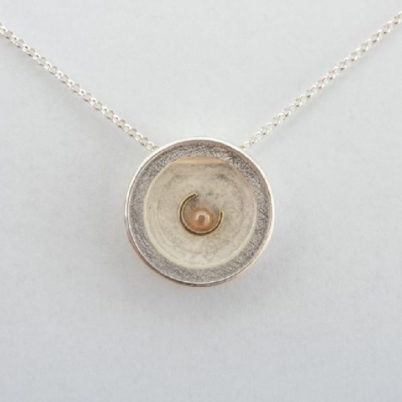Chapin Dimond, necklace, 21mm diameter x 6mm thick, sterling silver, 18k yellow, polished diamond sphere 0.37ct, sapphire crystal; photo: Kathryn Hill jewelry awards