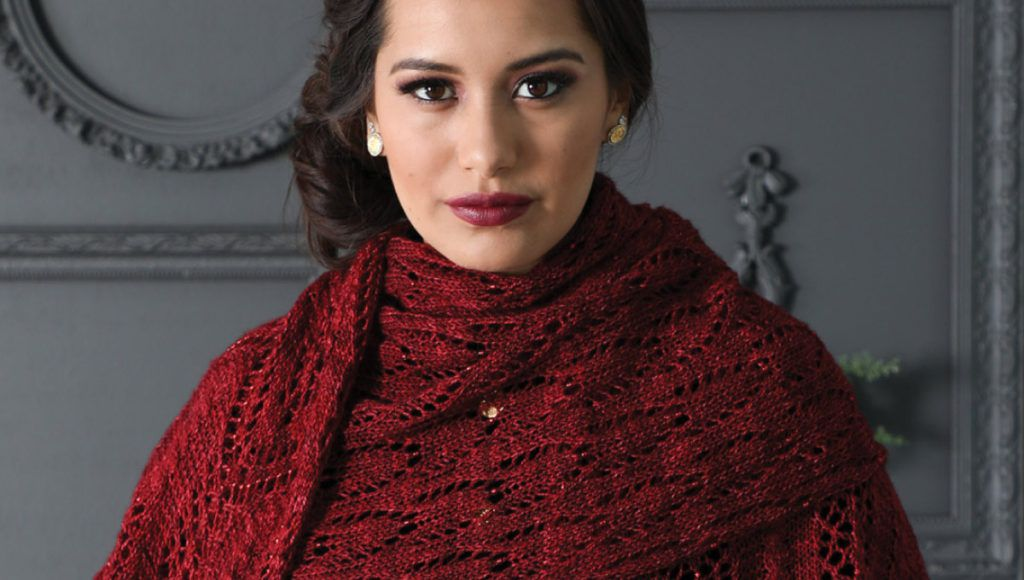 The Lucy Westenra's Stole in garnet red, modeled wrapped around the neck.