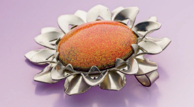 The Riveted Sterling Sunflower Pendant by Tom & Kay Benham was originally published in Lapidary Journal Jewelry Artist, December 2012; photo: Jim Lawson