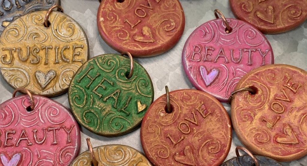 Polymer clay pendants by Andrew Thornton for Allegory Gallery at Beads of Courage