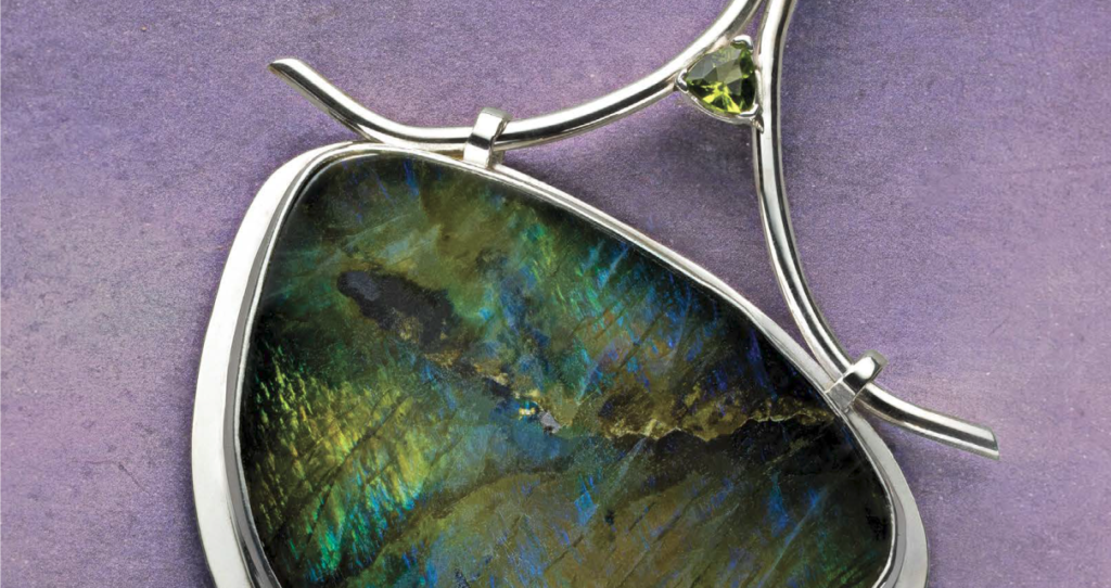 """ABOVE: Debra Hoffmaster's labradorite pendant with movable bail appears in """"Ready, Set, Move"""" in Lapidary Journal Jewelry Artist January/February 2021; photo: Jim Lawson"""