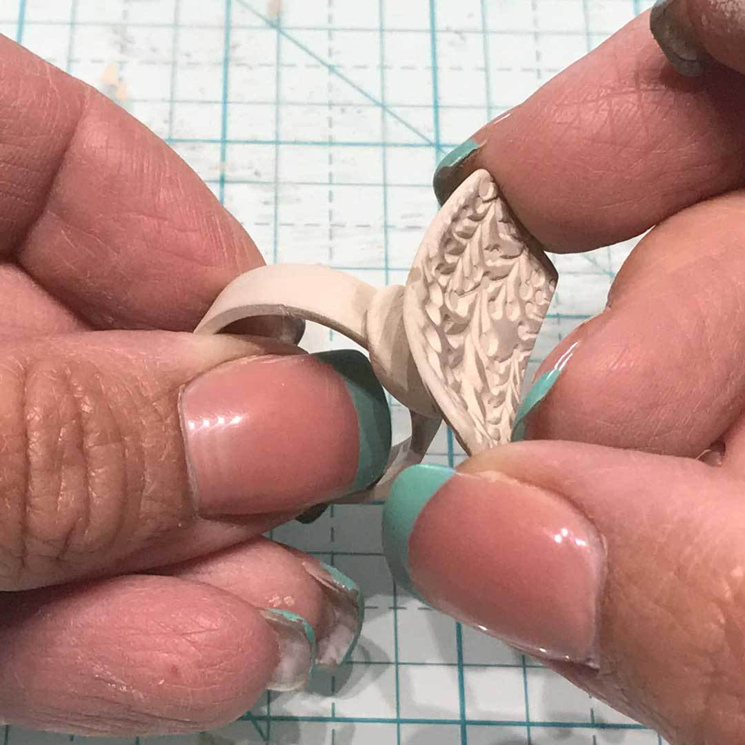 joining dried clay pieces