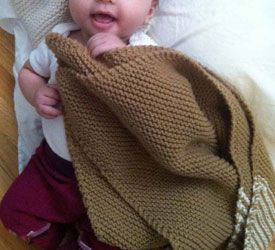 This easy knitting pattern of a knitted baby blanket is perfect for charity knitting.