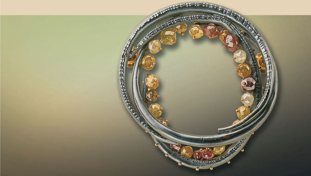 Todd Reed's forged silver, tapered tube and diamond bead brooch appeared as a project in Lapidary Journal Jewelry Artist November 2007; photo: Jim Lawson