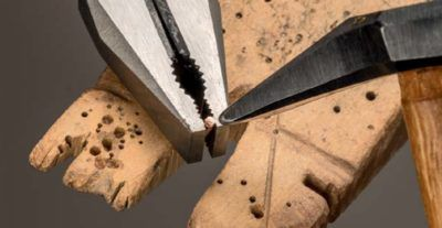 cold connections: flattening the head of a rivet using a riveting hammer