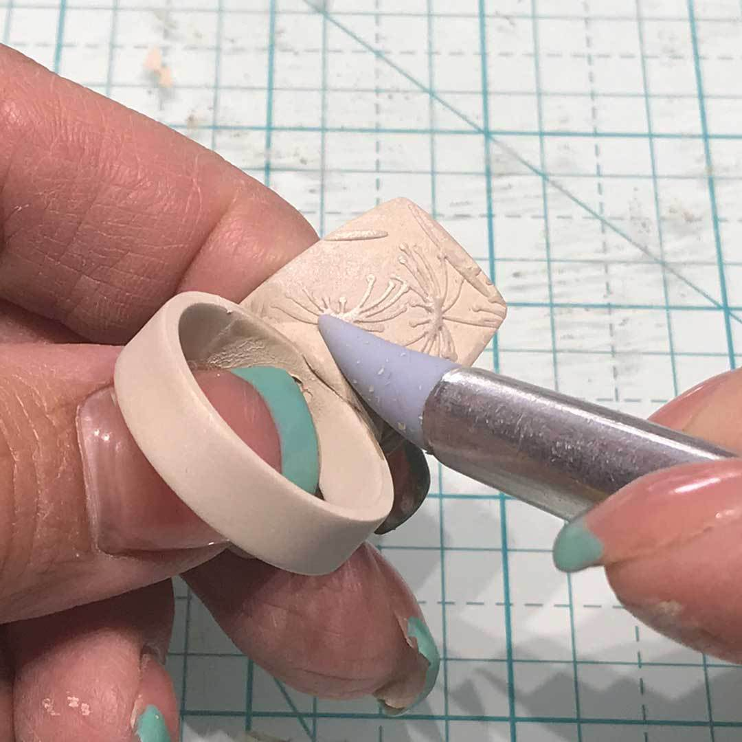 smooth clay with a silicone tip tool